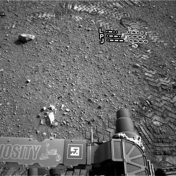 A file annotated image released by NASA on August 28, 2012 shows a close-up of track marks from the first test drive of NASA's Curiosity rover on Mars. Photo: AFP PHOTO / HANDOUT / NASA /JPL-Caltech / AFP