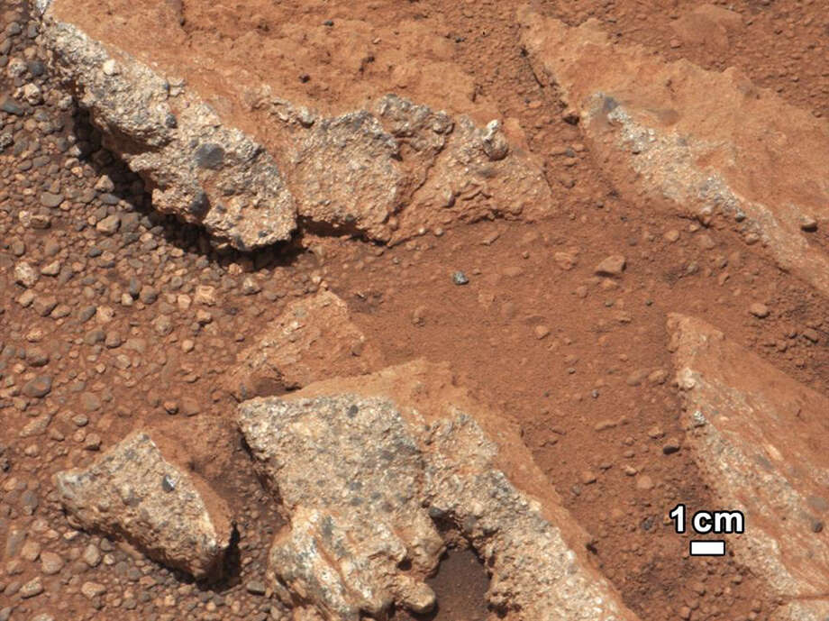 This image released on September 27, 2012  from NASA's Curiosity rover, shows a rock outcrop called Link that pops out from a Martian surface that is elsewhere blanketed by reddish-brown dust. NASA Photo: HO, AFP/Getty Images / AFP