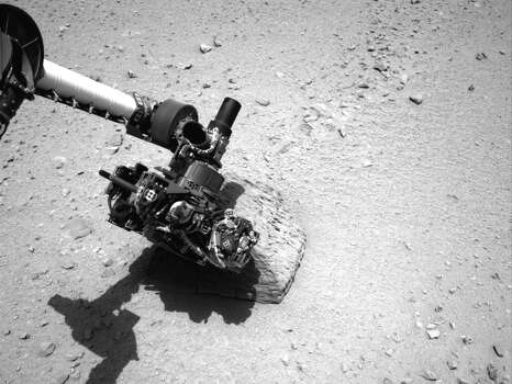 "An image provided by NASA shows the robotic arm of NASA's Mars rover Curiosity with the first rock touched by an instrument on the arm. The rover's right Navigation Camera made the image on Sept. 22, 2012. Curiosity placed the Alpha Particle X-Ray Spectrometer instrument onto the rock to assess what chemical elements were present in the rock. The rock is named ""Jake Matijevic"" in commemoration of influential Mars-rover engineer Jacob Matijevic. Photo: AP Photo/NASA / NASA"