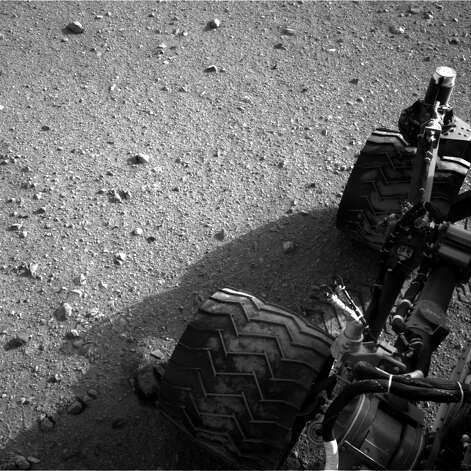 This image released by NASA on Wednesday Aug. 29,2012 shows Curiosity's wheels after it made its third drive on Mars. The six-wheel rover landed on Aug. 5, 2012 on a mission to study the red planet's environment. (AP Photo/NASA) Photo: Associated Press / NASA