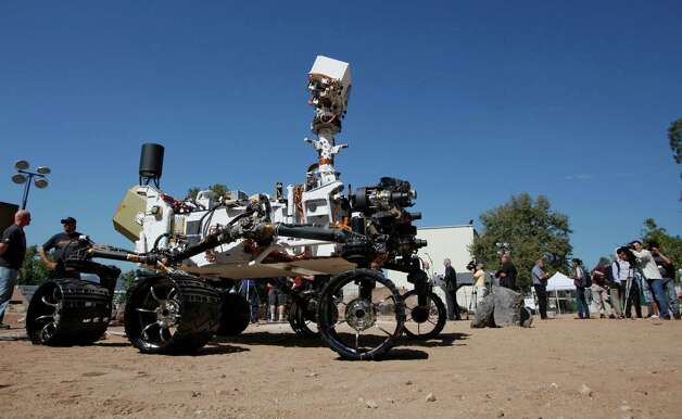 Nasa Mars Yard at Nasa's Jet Propulsion Laboratory is shown with a model of Mars robot, Curiosity, during a media demonstration, in Pasadena, Calif., Wednesday, July 25, 2012. On Sunday, Aug. 5th, after 8 and a half months in transit, Curiosity will parachute onto the Martian surface to hunt for the chemical building blocks of life. (AP Photo/Nick Ut) Photo: Nick Ut, Associated Press / AP