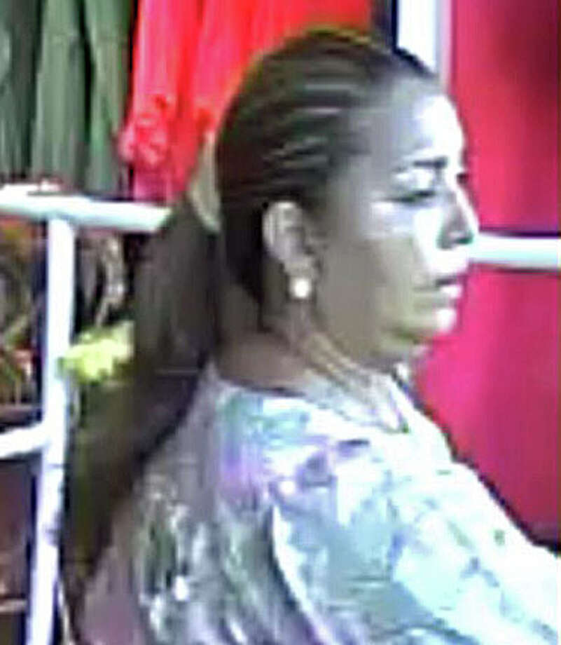 Police are looking for this woman in connection with a $3,114 theft from Apricot Lane in September. Photo: Contributed Photo / Fairfield Citizen