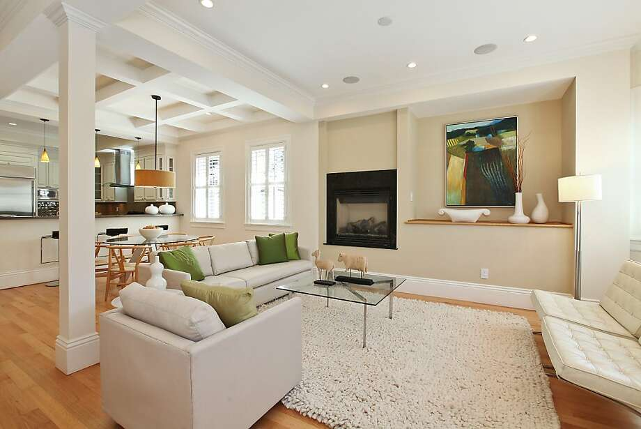 The home's living room shares an open space with the dining area. Photo: OpenHomesPhotography.com