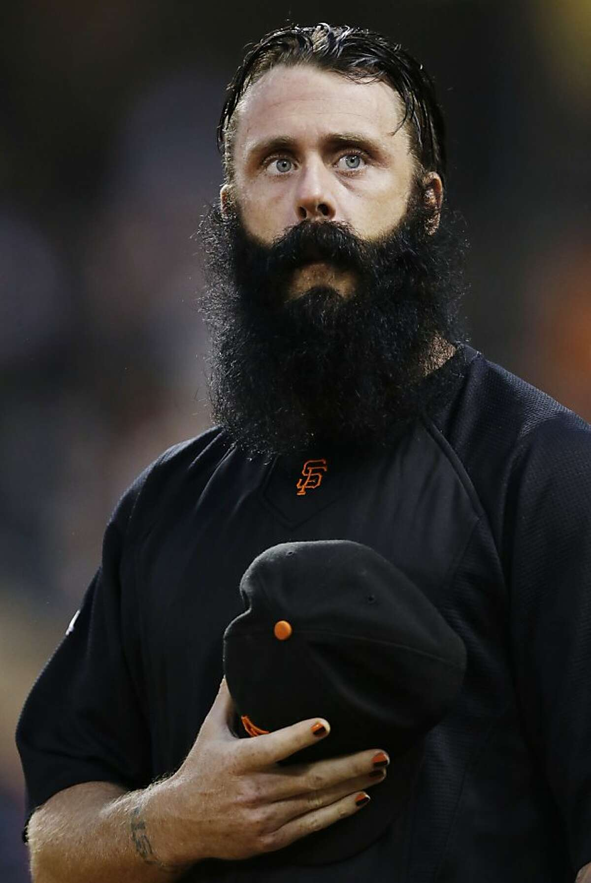 FILE - In this Sept. 25, 2012, file photo, San Francisco Giants relief pitcher Brian Wilson looks on from the dugout during a baseball game against the Arizona Diamondbacks in San Francisco. Wilson is scheduled to throw Oct. 19 for the first time since Tommy John surgery, and the always-confident closer insists he will be full strength by next year.