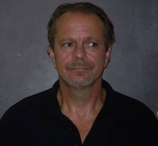 Two former Milford residents were arrested Thursday, Oct. 4 in connection with a murder-for-hire plot, police said. The two   50-year-old Gregory Christofakis and 44-year-old Ziba Guy, both of whom now live on Marsh Hill Road in Orange, had planned to solicit the murder and assault of two people, police said. Photo: Contributed Photo