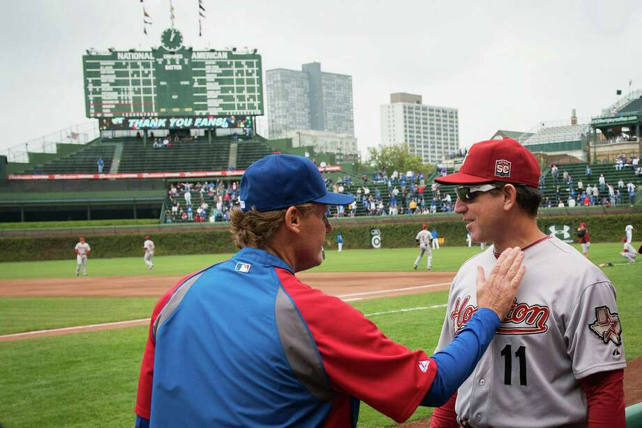 Astros interim manager Tony DeFrancesco gets a hand from a Chicago Cubs coach before the season finale. Photo: Smiley N. Pool, Houston Chronicle / © 2012  Smiley N. Pool