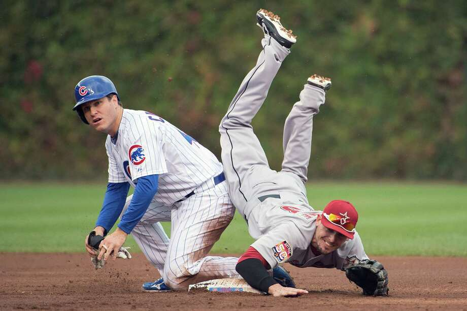 Astros second baseman Tyler Greene is upended by Cubs baserunner Adrian Cardenas as he completes a double play during the second inning. Photo: Smiley N. Pool, Houston Chronicle / © 2012  Smiley N. Pool