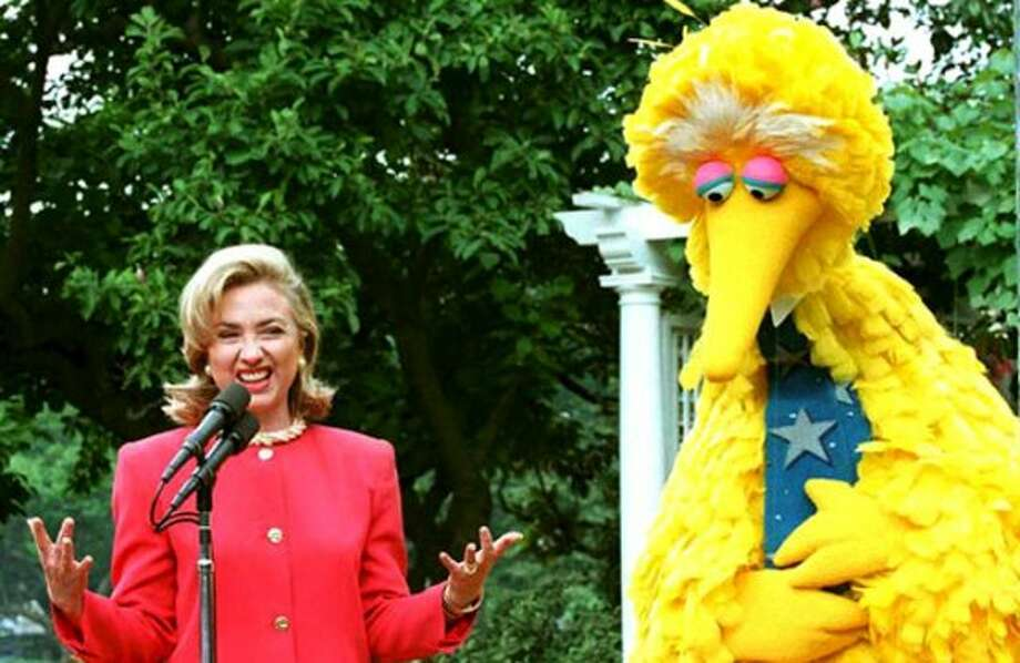 Former First Lady Hillary Clinton poses with Big Bird (National Archives)
