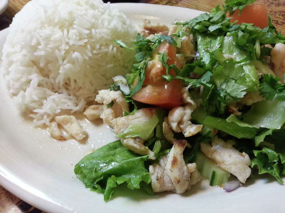 The Thai meat salad at Baitong comes with red onioin, cucumbers, lettuce, green onion and a choice of meat. Photo: Jennifer McInnis, San Antonio Express-News