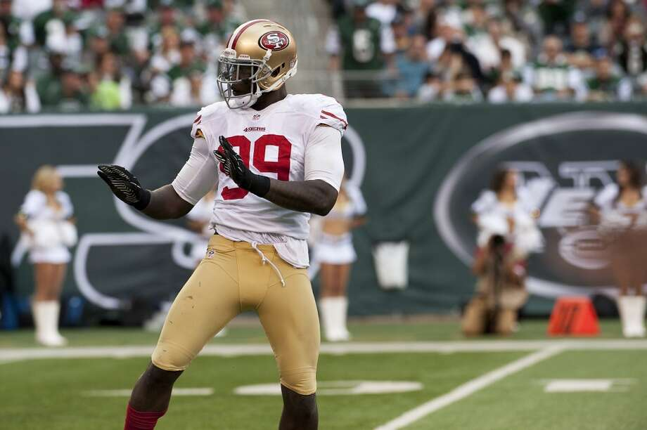 Aldon Smith celebrates after sacking Jets QB Mark Sanchez.