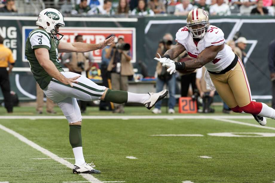 Larry Grant blocks a punt by Robert Malone during the San Francisco 49ers victory against the New York Jets.