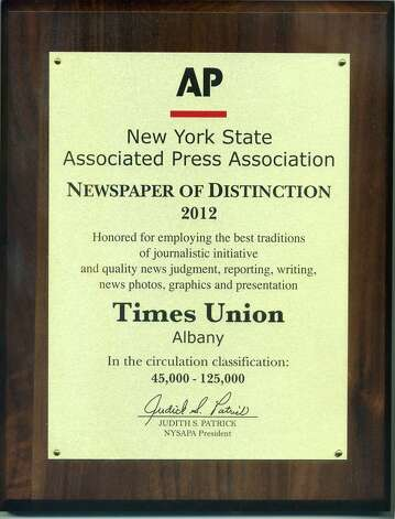 Plaque presented to the Times Union on Oct. 3, 2012 by the New York State Associated Press Association. The Times Union was named New York?s Newspaper of Distinction, the top award in its circulation class, at the annual banquet of the association. The newspaper?s staff also won 11 individual awards, including five first-place citations. The Newspaper of Distinction award came in the 45,000-to-125,000 circulation category.  Judges cited the newspaper's writing, political coverage and its committment to in-depth reporting, specifically a series on NXIVM, a more-than-yearlong examination of the Capital Region-based self-improvement guru and conceptual founder of NXIVM. Photo: Times Union