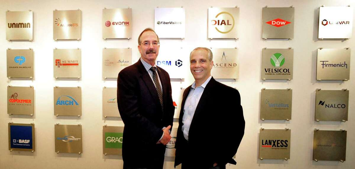 Bob Shellman, CEO and president of Odyssey Logistics & Technology Corporation, left, and Cosmo Alberico, executive vice president and CFO, are surrounded by plaques that indicate a sampling of Odyssey's worldwide customers in their Danbury offices Thursday, Oct. 4, 2012.