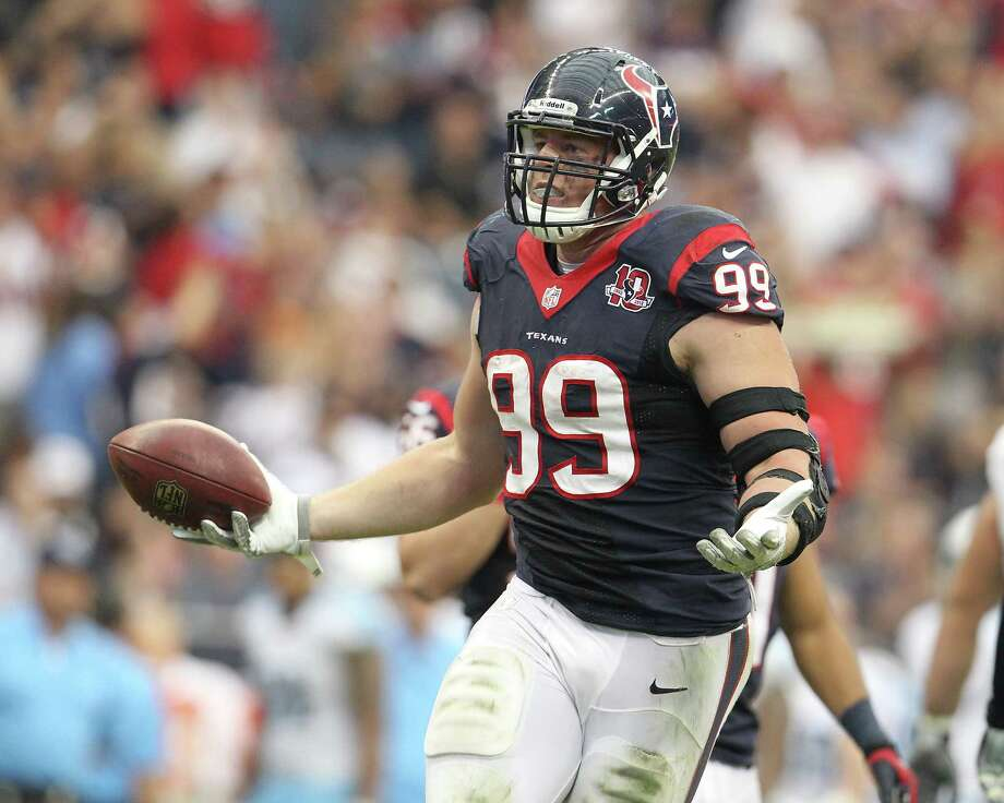 Texans defensive end J.J. Watt, recovering a fumble against Tennessee last week, was voted the AFC defensive player of the month after posting 7½ sacks and 10 tackles for loss. Photo: Karen Warren, Houston Chronicle / © 2012  Houston Chronicle