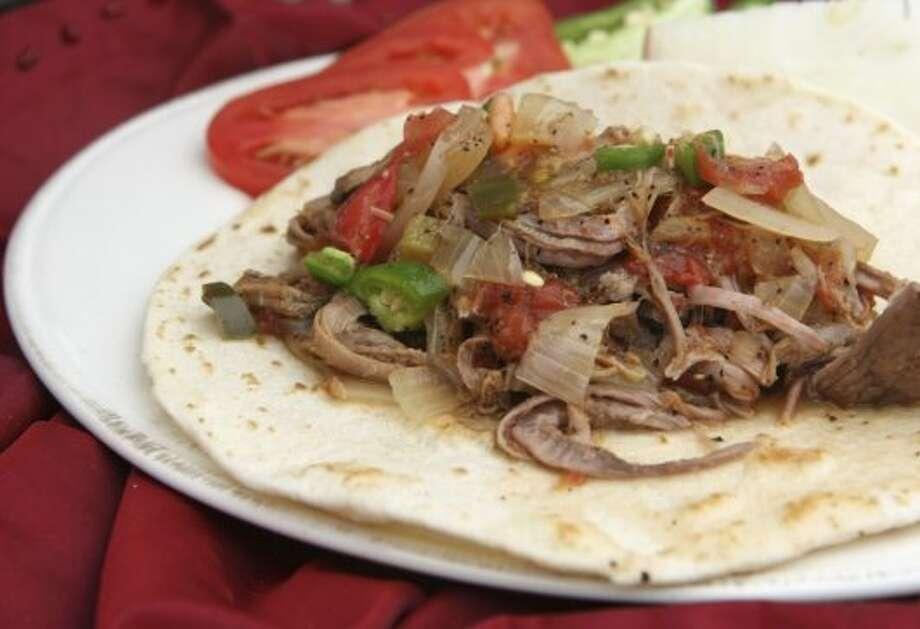 The carne deshebrada taco from Chela's Tacos, visit chelas-tacos.com