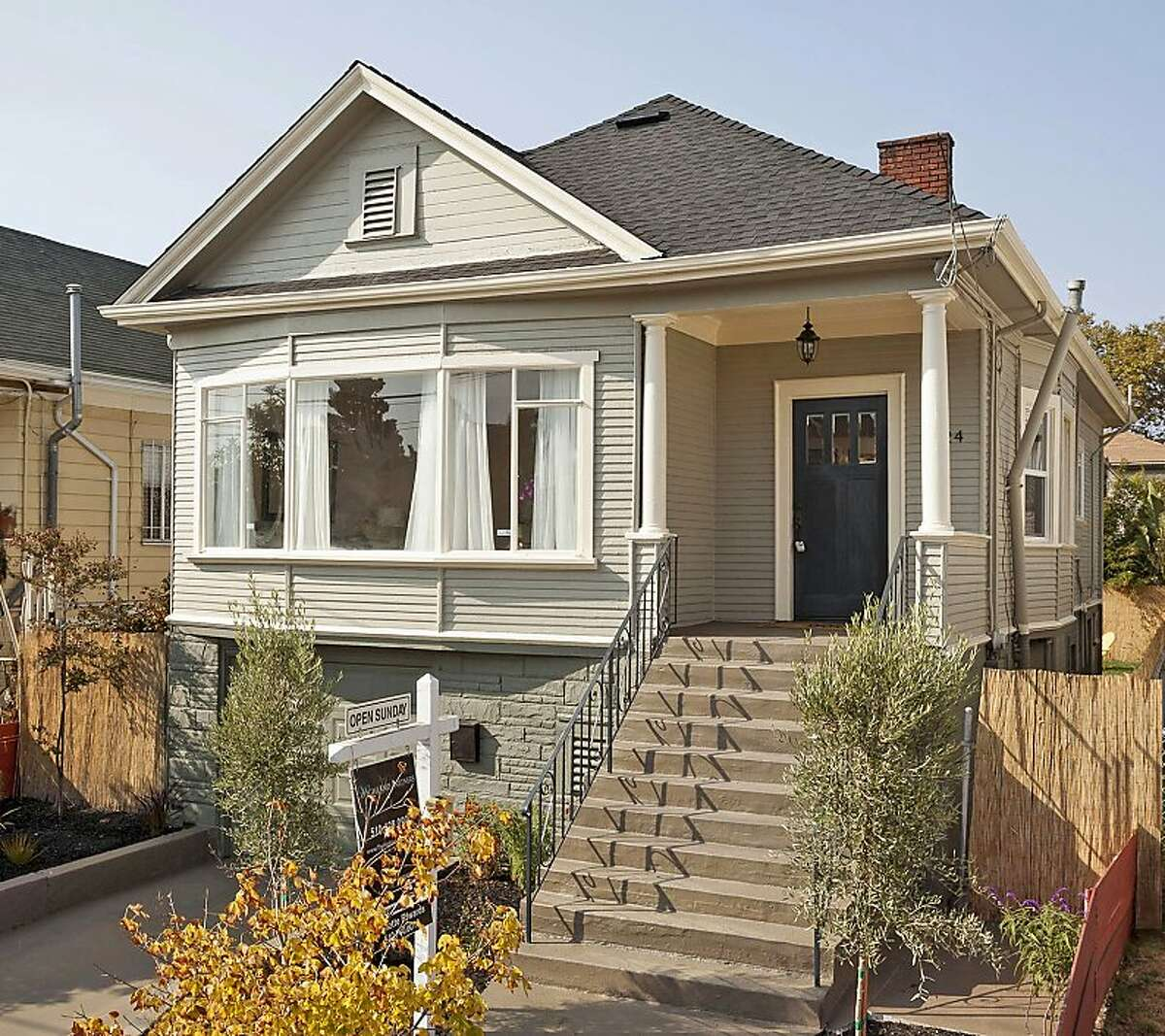 A bay window overlooks the front of this two-bedroom bungalow in the North Oakland, Berkeley, Emeryville area. Opportunities to purchase competitively priced homes are drawing young professionals to this vibrant neighborhood.