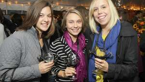 Altamont, NY - September 28, 2012 - (Photo by Joe Putrock/Special to the Times Union) - (l to r)Allisen Moore, Kyra McTighe and Laura Weinman try some of the Altamont Vineyard and Winery's best wines during the third annual HalloWine Festival, a benefit for Wildwood Programs.
