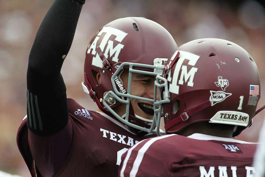 Texas A&M quarterback Johnny Manziel (2) celebrates his touchdown in the fourth quarter of a college football game at Kyle Field, Saturday, Sept. 29, 2012, in College Station. Texas A&M beat Arkansas 58-10. Photo: Karen Warren, Houston Chronicle / © 2012  Houston Chronicle