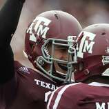 Texas A&M quarterback Johnny Manziel (2) celebrates his touchdown in the fourth quarter of a college football game at Kyle Field, Saturday, Sept. 29, 2012, in College Station. Texas A&M beat Arkansas 58-10.
