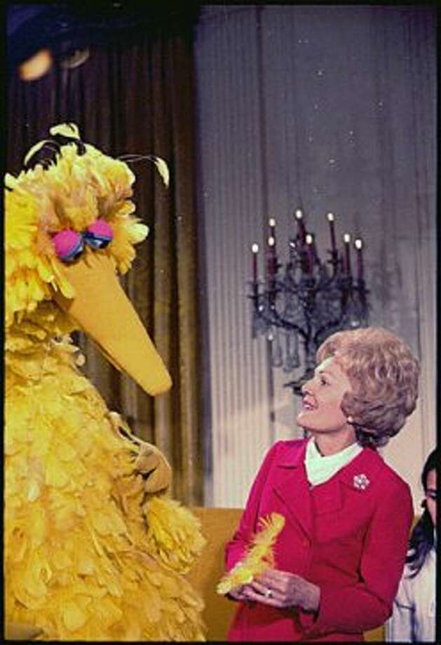 Former First Lady Pat Nixon meeting with Big Bird from Sesame Street in the White House, Dec. 20, 1970 (National Archives)
