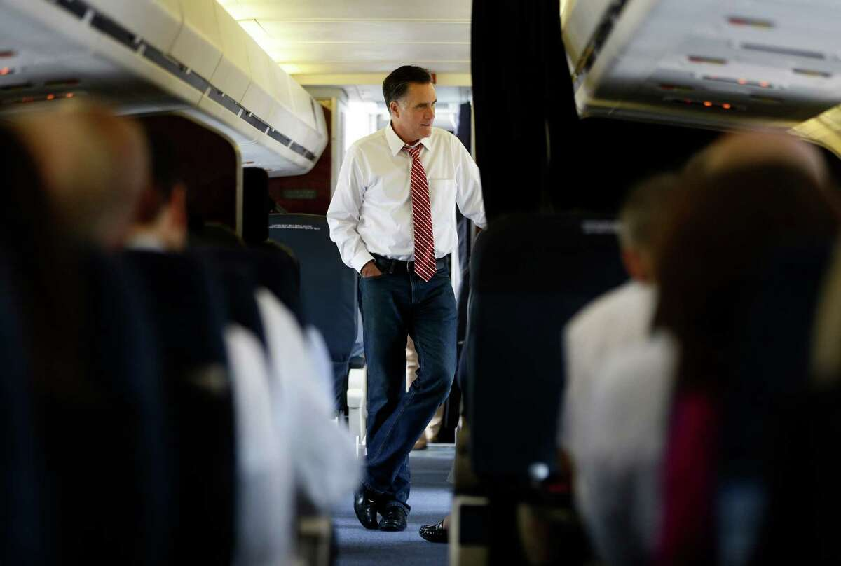 Republican presidential candidate and former Massachusetts Gov. Mitt Romney speaks to advisers on his campaign plane in Denver, Thursday, Oct. 4, 2012. (AP Photo/Charles Dharapak)