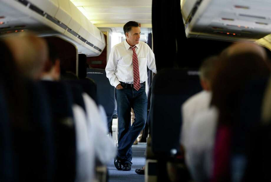 Republican presidential candidate and former Massachusetts Gov. Mitt Romney speaks to advisers on his campaign plane in Denver, Thursday, Oct. 4, 2012. (AP Photo/Charles Dharapak) Photo: Charles Dharapak, Associated Press / AP