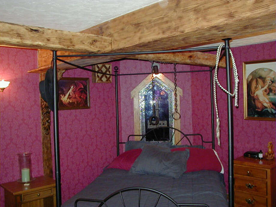 The most unusual feature is the dungeon, which touts such decor as swords, a mace and shackles, including in the three bedrooms, a Jacuzzi and a steam shower. Photo: Troll Haven