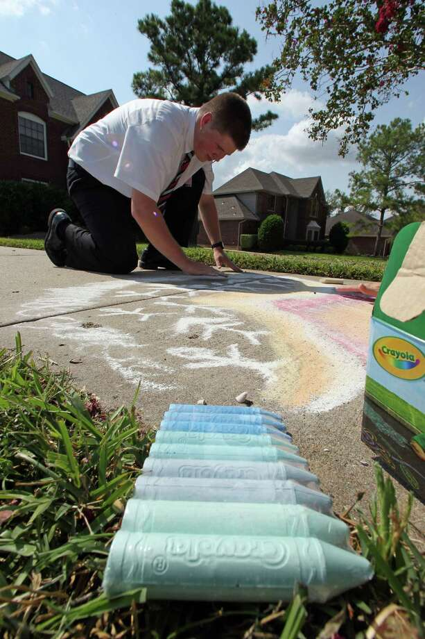 Elder Ryan MacCarthy draws sidewalk art in parks, neighborhoods and public areas hoping people will inquire and give him an opportunity to talk about the LDS church.  Photo: James Nielsen / © Houston Chronicle 2012