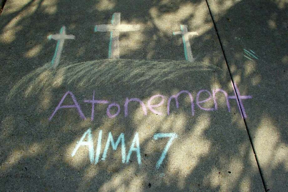 Sidewalk art illustrates Mormon scriptures Photo: James Nielsen / © Houston Chronicle 2012