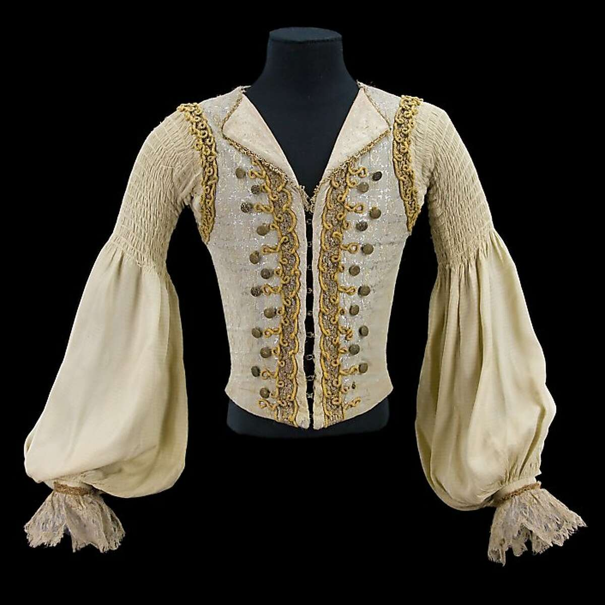 Costume by Nicholas Giorgiadis, doublet for Rudolf Nureyev in the role of Prince Florimond, Act III, in Sleeping Beauty, Teatro alla Scala, Milan, 1966. Sleeveless gray and silver waistcoat trimmed with gold lace, yellow braid, and gold filigree buttons; white false shirt with pleated sleeves and lace cuffs. Collection CNCS/Rudolf Nureyev Foundation.