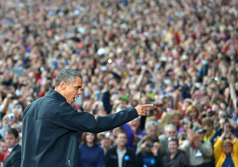 President Obama gestures to supporters as he arrives for a rally at the University of Wisconsin-Madison, returning to the campaign trail after Wednesday's debate. Photo: Mandel Ngan, AFP/Getty Images