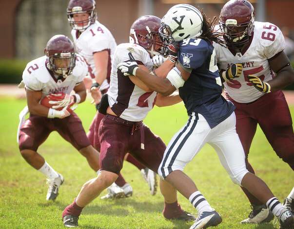 Milford Academy fullback Mike Rivas, of Stamford, blocks a Yale defender in his team's victory over Yale University's practice squad on Sunday, September 30, 2012. Photo: Brian A. Pounds / Connecticut Post