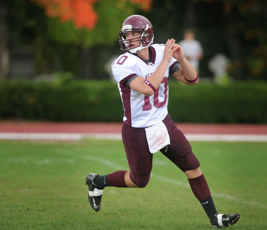 Milford Academy quarterback Elliott Chudwick, of Ansonia, looks to fake out the defense after a hand off in his team's victory over Yale University's practice squad on Sunday, September 30, 2012. Photo: Brian A. Pounds / Connecticut Post