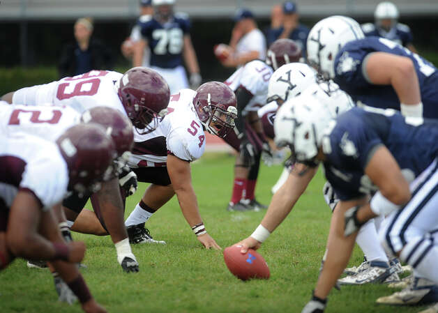 Milford Academy starting linebacker Kyle Camacho, center, of Greenwich, lines up on defense during his team's victory over Yale University's practice squad in New Haven on Sunday, September 30, 2012. Photo: Brian A. Pounds / Connecticut Post