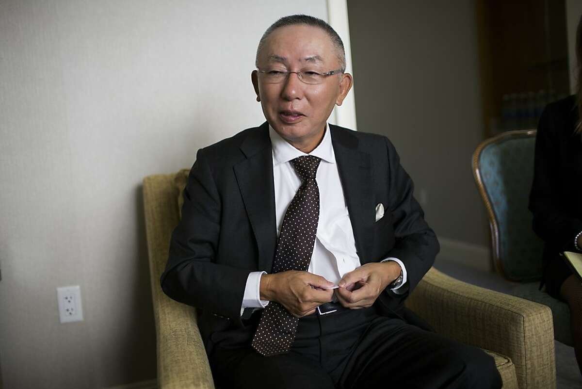 Uniqlo CEO Tadashi Yanai displays his company's undershirt during an interview at the Four Season Hotels in San Francisco, Calif. on Wednesday, Oct. 4, 2012.