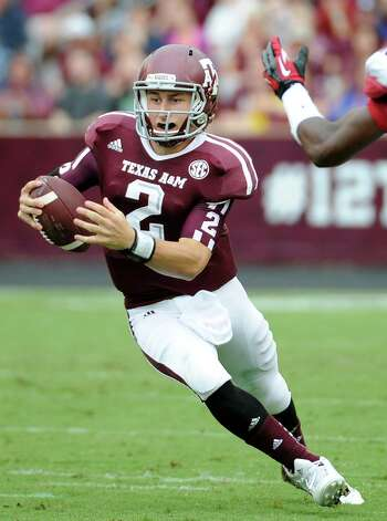 A&M's Johnny Manziel broke the SEC record for total yards last week. He had 557, surpassing the 540 of Ole Miss's Archie Manning (1969) and LSU's Rohan Davey (2001). Photo: Pat Sullivan, Associated Press / AP