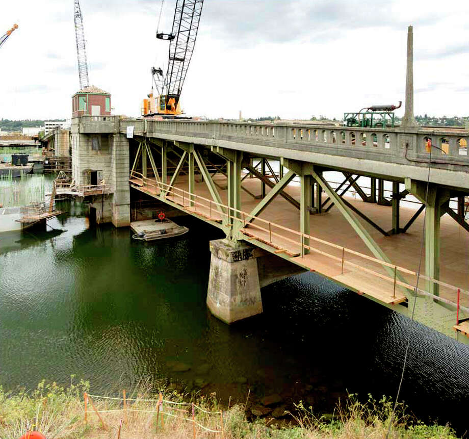 A plywood deck was installed under the old bridge to protect the river from debris when it is demolished. The south span will be torn down this year, while the north side will be removed in 2013. Photo: John Stamets / 2012