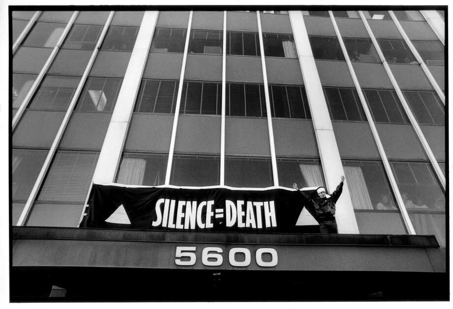 """In an undated handout photo, Peter Staley finishes hanging banner over the entrance to the FDA main headquarters in the documentary """"How to Survive a Plague."""" The documentary, created by David France, is a history of the fiery force of activists group Act Up in the life-or-death fight for drugs to treat AIDS. (William Lucas Walker/Sundance Selects via The New York Times) -- NO SALES; FOR EDITORIAL USE ONLY WITH STORY SLUGGED PLAGUE FILM REVIEW BY STEPHEN HOLDEN. ALL OTHER USE PROHIBITED. -- Photo: WILLIAM LUCAS WALKER / SUNDANCE SELECTS"""