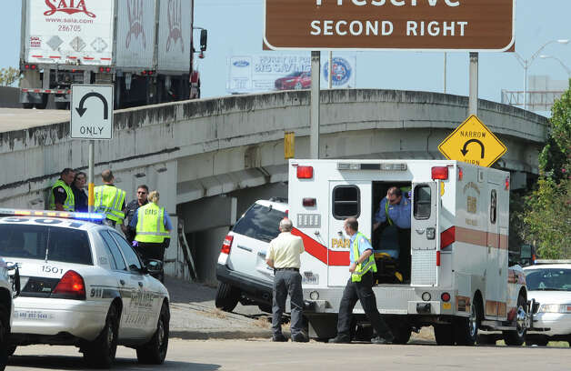 Beaumont Police are searching for a black SUV that struck a police vehicle on the Interstate 10 feeder road then drove off. One of the four officers received minor injuries in the incident.  Photo taken Thursday, October 4, 2012 Guiseppe Barranco/The Enterprise Photo: Guiseppe Barranco, STAFF PHOTOGRAPHER / The Beaumont Enterprise
