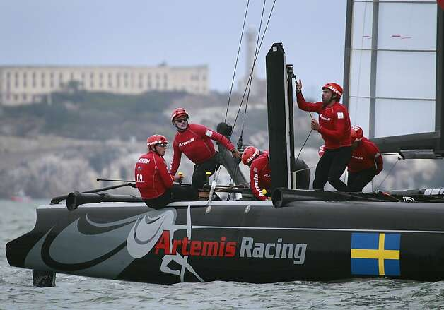 The Artemus Racing White team beats Team Korea in a quarterfinals race of the America's Cup World Series in San Francisco, Calif. on Thursday, Oct. 4, 2012. Photo: Paul Chinn, The Chronicle