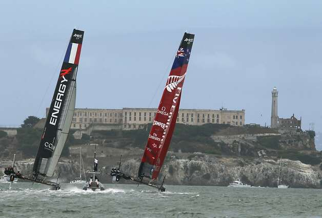 Energy Team of France and Emirates Team New Zealand go head-to-head in a quarterfinals race of the America's Cup World Series in San Francisco, Calif. on Thursday, Oct. 4, 2012. Photo: Paul Chinn, The Chronicle