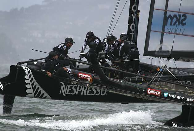 Emirates Team New Zealand sailors maneuver during their quarterfinal match race victory over Energy Team of France on San Francisco Bay. Photo: Paul Chinn, The Chronicle