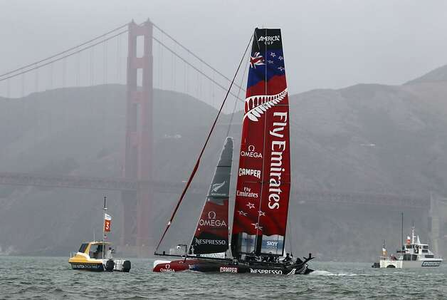 Emirates Team New Zealand rounds a mark near the Golden Gate Bridge enroute to a win over Energy Team of France in a quarterfinals match of the America's Cup World Series in San Francisco, Calif. on Thursday, Oct. 4, 2012. Photo: Paul Chinn, The Chronicle