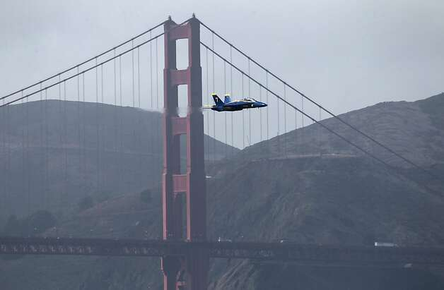 A Blue Angels F/A 18 jet flies past the Golden Gate Bridge during practice in between quarterfinals races of the America's Cup World Series in San Francisco, Calif. on Thursday, Oct. 4, 2012. Photo: Paul Chinn, The Chronicle