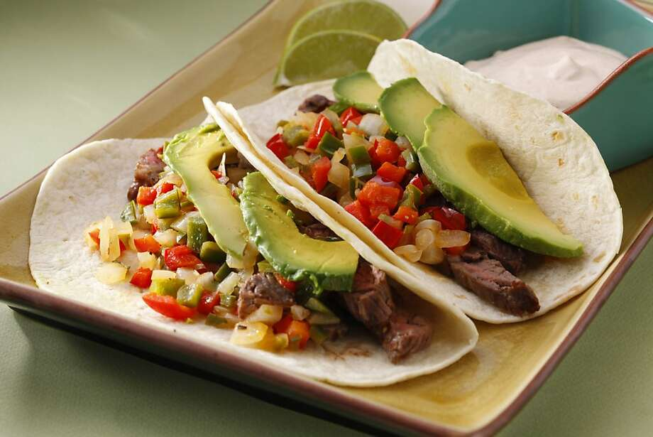 Carne Asada Tacos With Warm Pepper Salsa; styling by Amanda Gold Photo: Craig Lee, Special To The Chronicle