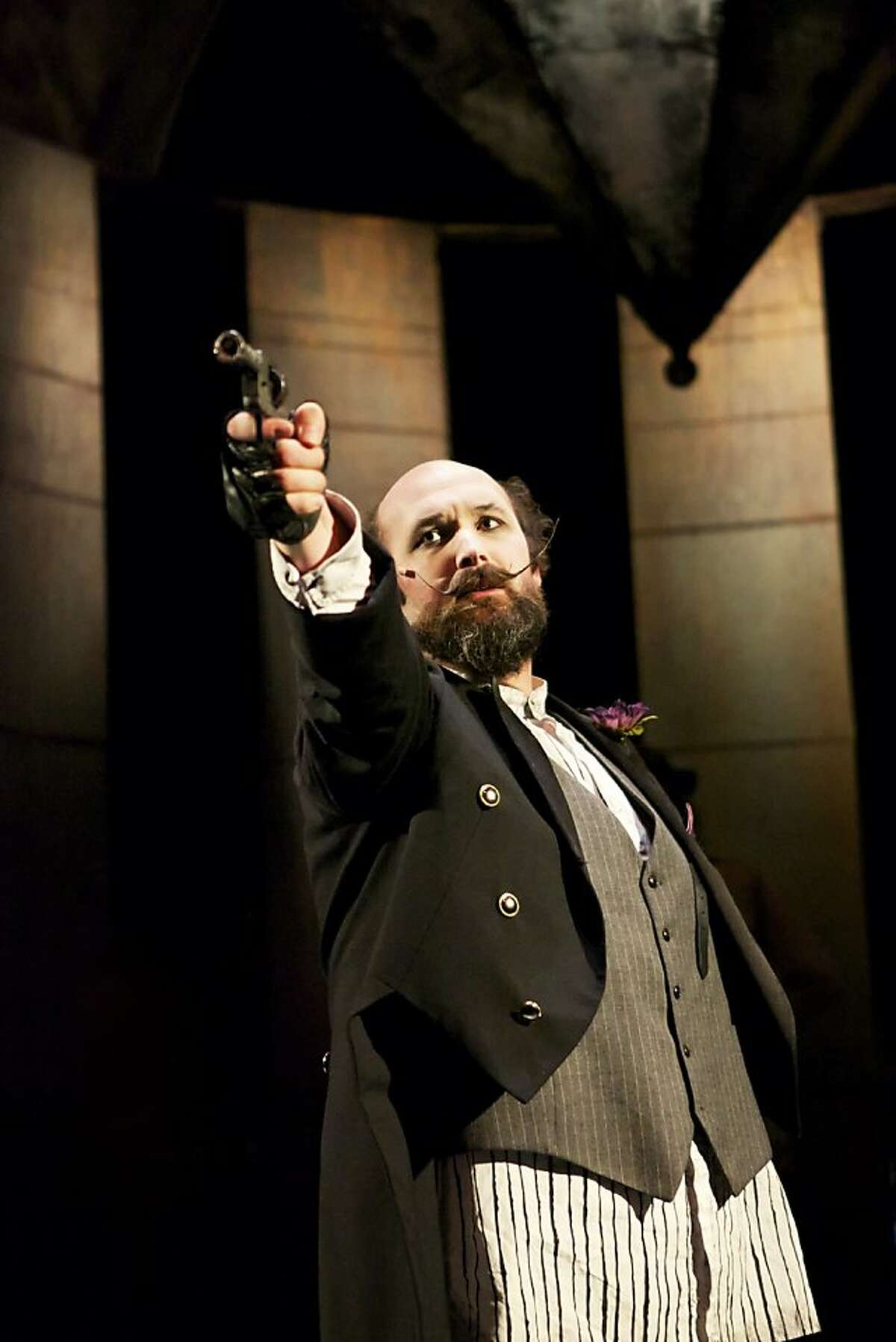 Charles Guiteau (Steven Hess) prepares to shoot a president in Shotgun Players' production of the Stephen Sondheim musical