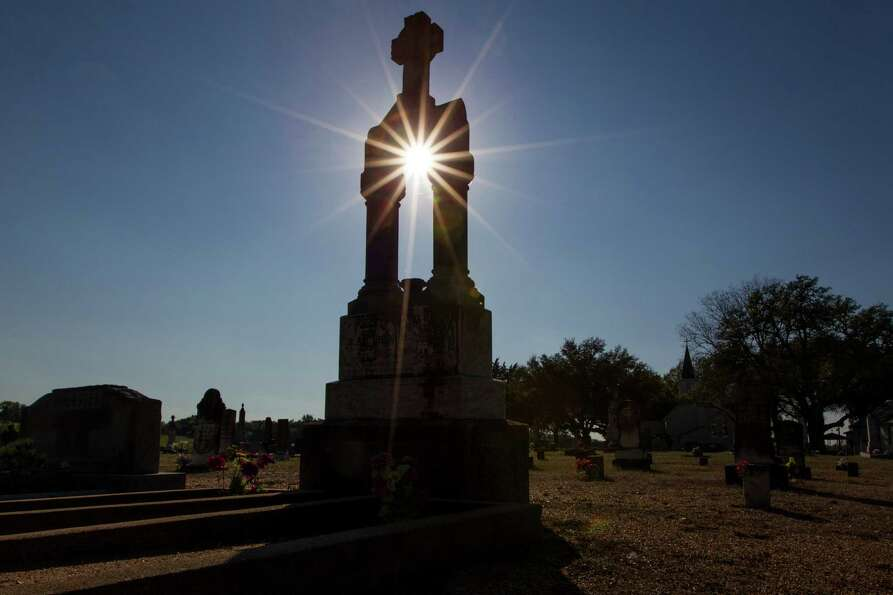 Sunlight shines through a monument in the cemetery at United Evangelical Lutheran Church  in Swis