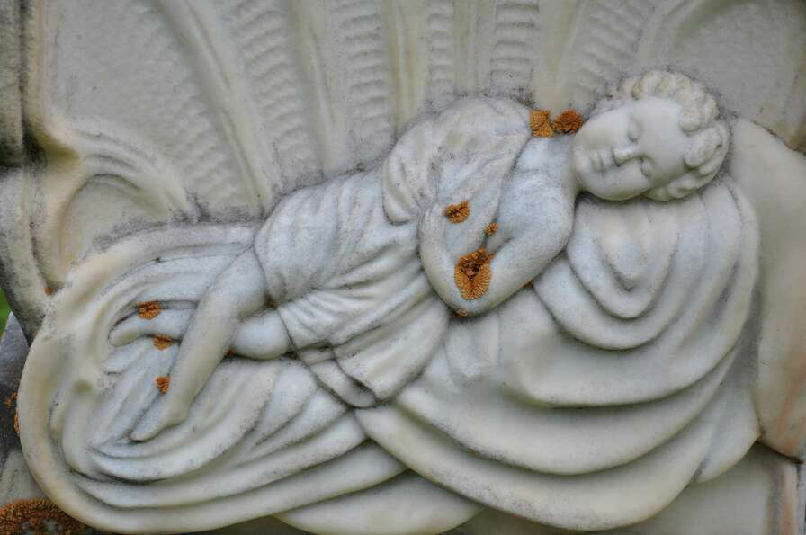 Detail from the grave of a child buried in 1892, at Logan City Cemetery in Logan, Utah.