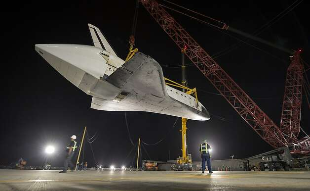 Space shuttle Endeavour is offloaded at the Los Angeles International Airport, where it waits for its two-day celebratory crawl over city streets to its permanent home at the California Science Center. Photo: Bill Ingalls, Associated Press