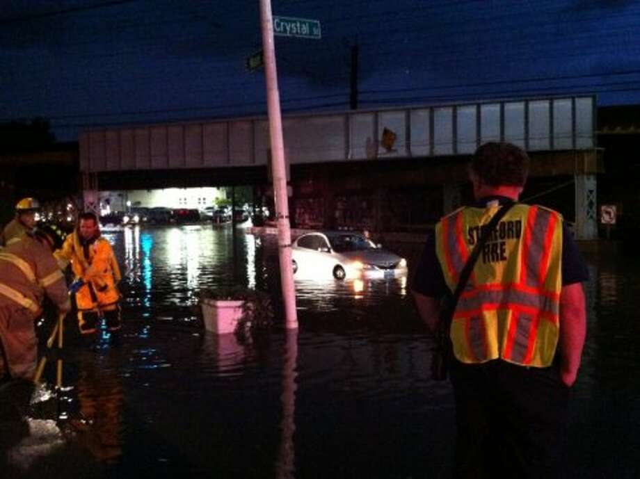 A car is stranded in water Thursday, Oct. 4, 2012, on East Main Street in Stamford. (Brett Mickelson)